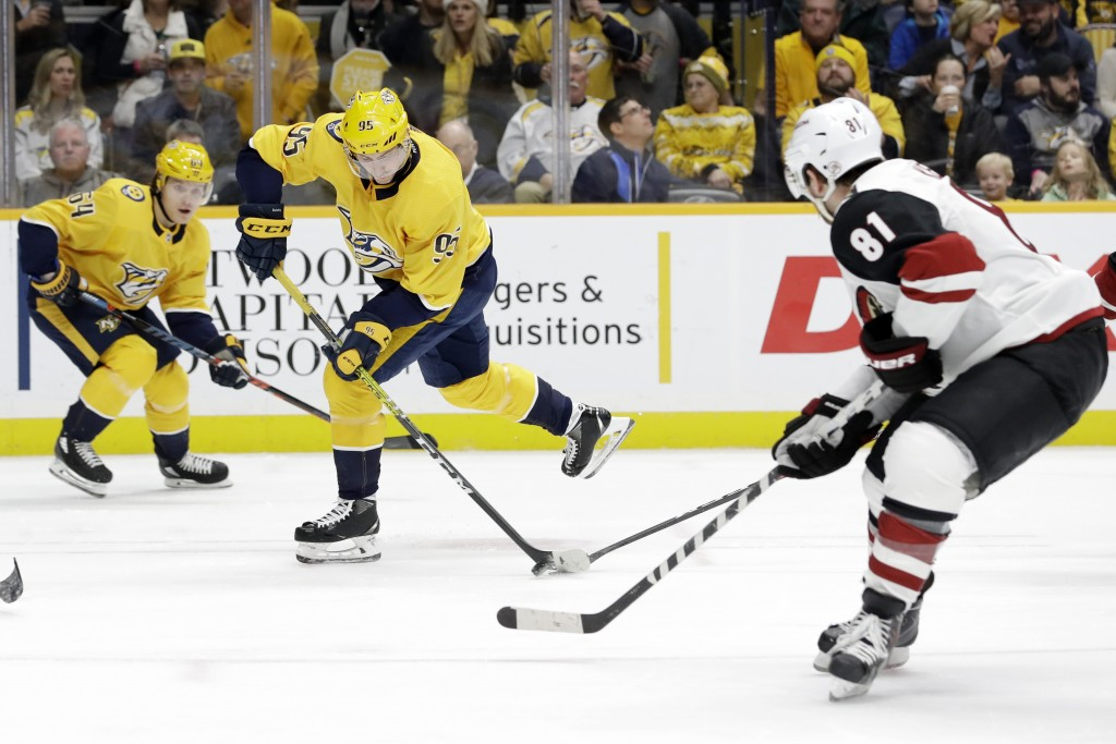 Nashville Predators center Matt Duchene (95) shoots against the Arizona Coyotes during the second period of an NHL hockey game Monday, Dec. 23, 2019, ...