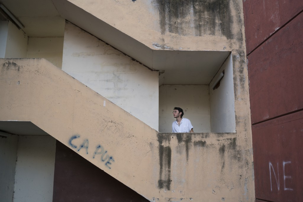 In this photo taken on Dec. 15, 2019, Vincent Achour, a psychiatry intern on strike climbs the concrete stairs leading the the intern residency at Mar...