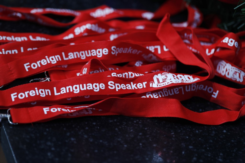 Lanyards stand at the ready for volunteers who speak foreign languages to wear while answering telephones in the NORAD Tracks Santa center at Peterson...