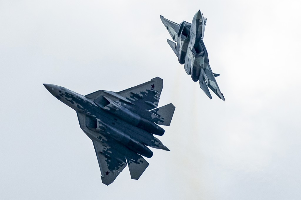 FILE - In this file photo taken on Tuesday, Aug. 27, 2019, Russian Air Force Sukhoi Su-57 fifth-generation fighter jets perform during the MAKS-2019 I...