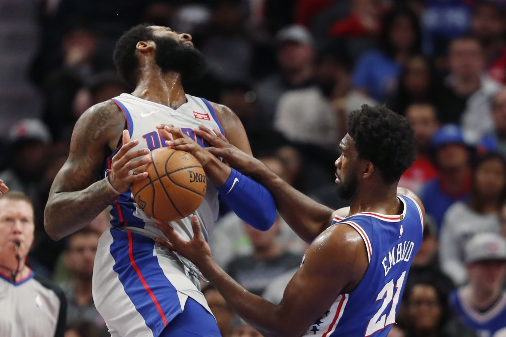 Detroit Pistons center Andre Drummond, left, and Philadelphia 76ers center Joel Embiid (21) try to control the ball during the first half of an NBA ba...