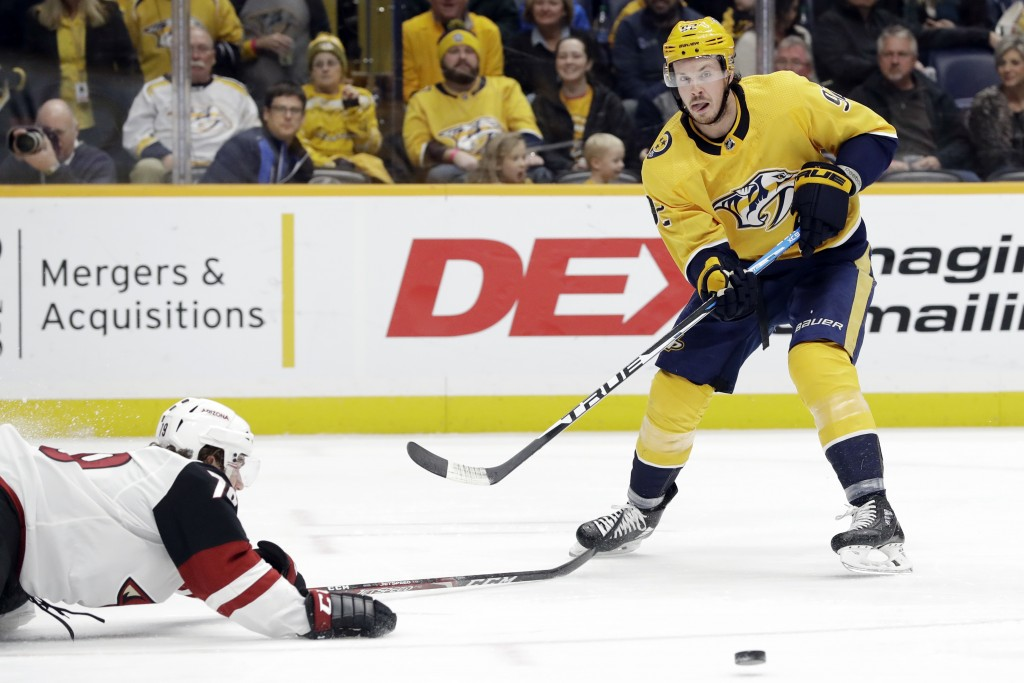 Nashville Predators center Ryan Johansen (92) passes the puck past Arizona Coyotes right wing Jordan Gross (79) during the second period of an NHL hoc...