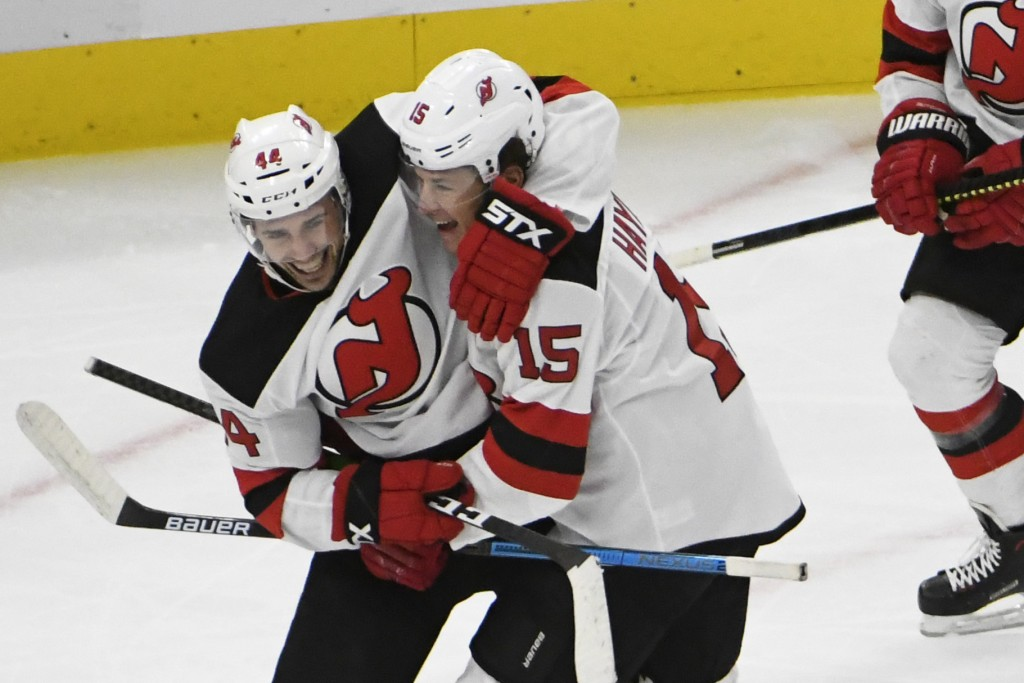 New Jersey Devils center John Hayden (15) celebrates his goal against the Chicago Blackhawks with left wing Miles Wood (44) during the second period o...