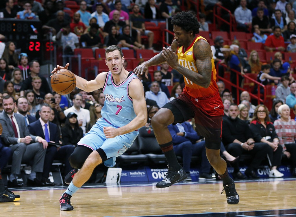 Miami Heat guard Goran Dragic (7) drives to the basket against Utah Jazz center Ed Davis (17) during the first half of an NBA basketball game, Monday,...