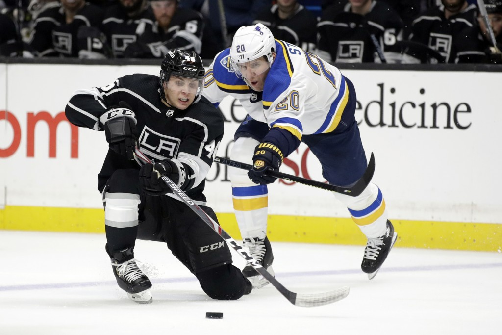 Los Angeles Kings' Blake Lizotte, left, is defended by St. Louis Blues' Alexander Steen during the second period of an NHL hockey game Monday, Dec. 23...