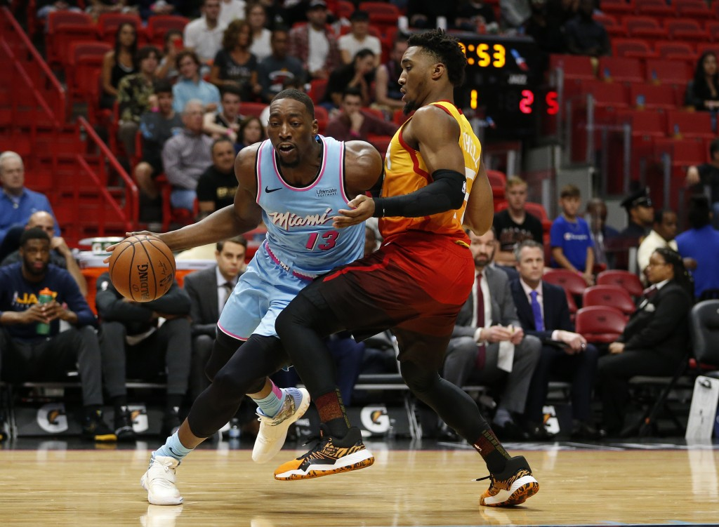 Miami Heat center Bam Adebayo (13) drives to the basket against Utah Jazz guard Donovan Mitchell (45) during the first half of an NBA basketball game,...