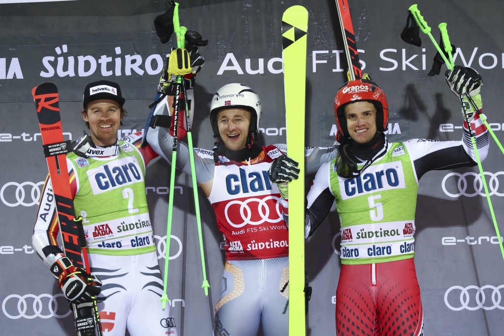 Norway's Rasmus Windingstad, center, winner of an alpine ski, men's World Cup parallel giant slalom, poses on the podium with second placed Germany's ...