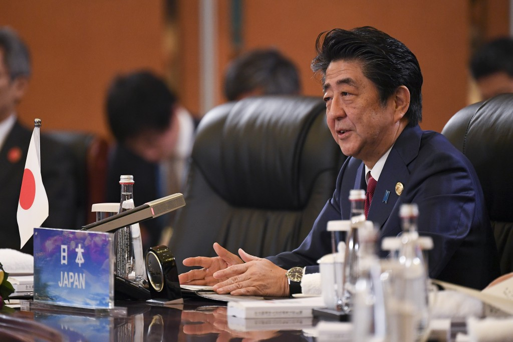 Japan's Prime Minister Shinzo Abe speaks at the trilateral leaders' meeting between China, South Korea and Japan in Chengdu, in southwest China's Sich...