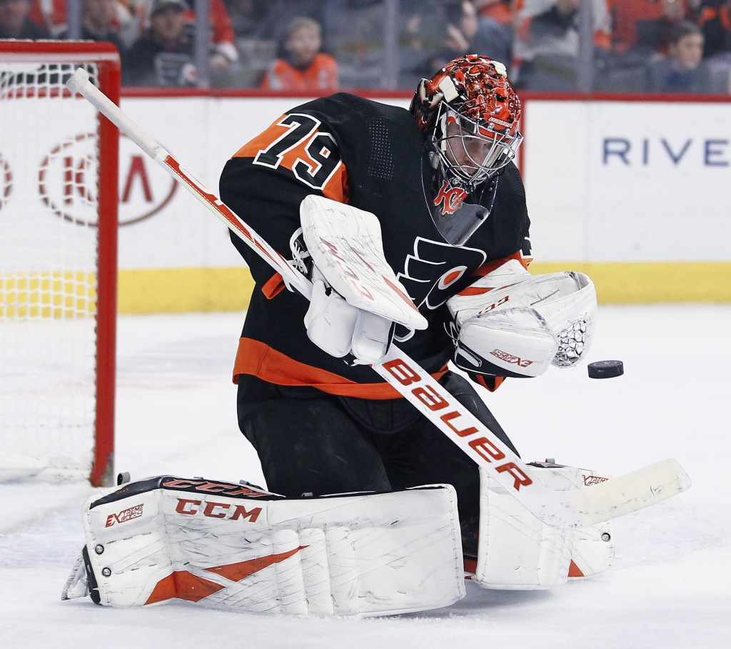 Philadelphia Flyers' Carter Hart stops a shot on goal during the first period of an NHL hockey game against the New York Rangers, Monday, Dec. 23, 201...