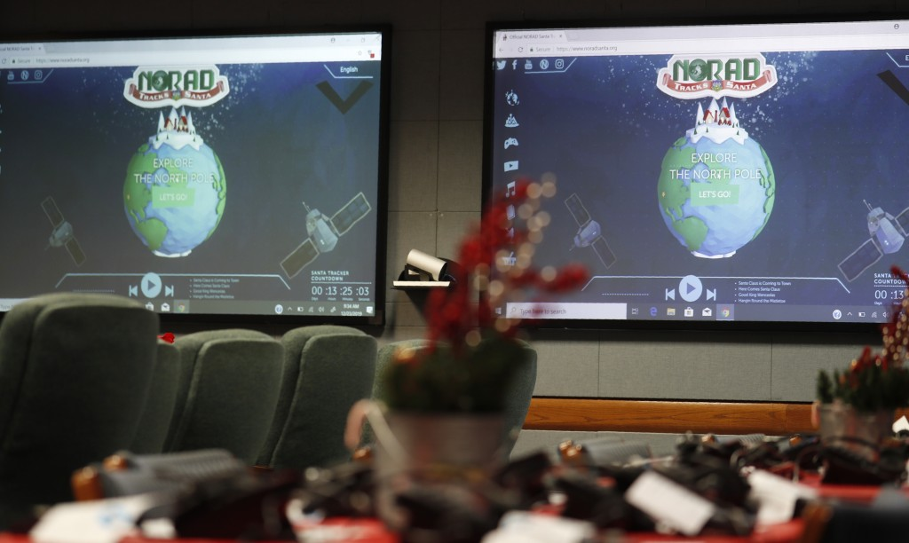 Monitors are illuminated in the NORAD Tracks Santa center at Peterson Air Force Base, Monday, Dec. 23, 2019, in Colorado Springs, Colo. More than 1,50...