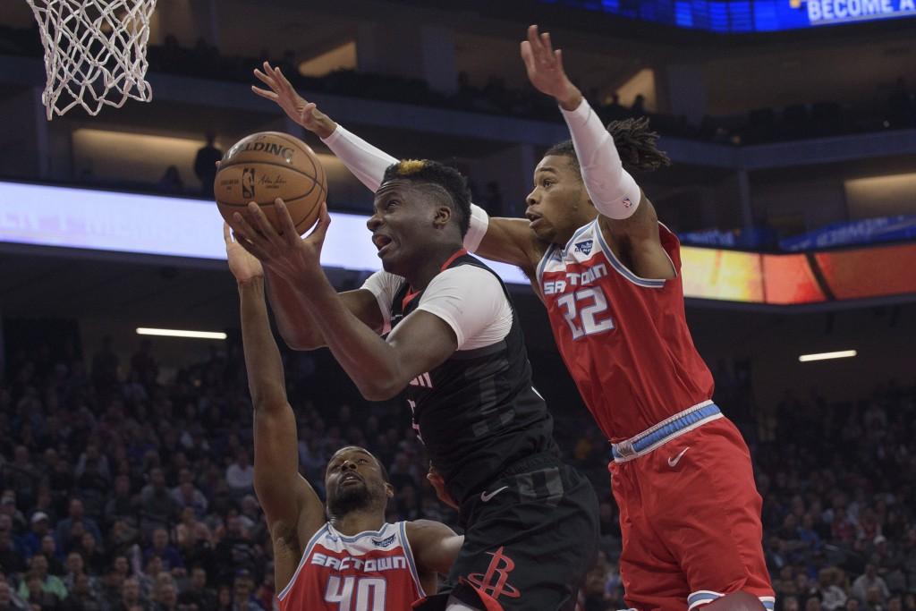 Houston Rockets center Clint Capela (15) drives to the basket as Sacramento Kings forward Harrison Barnes (40) and Sacramento Kings forward Richaun Ho...