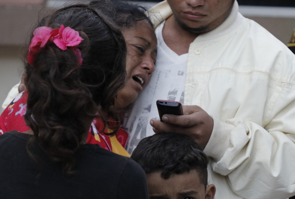 A woman cries outside the morgue after learning her husband, Dionisio Heriberto Solis, is one of the prisoners who died in a riot inside El Porvenir p...