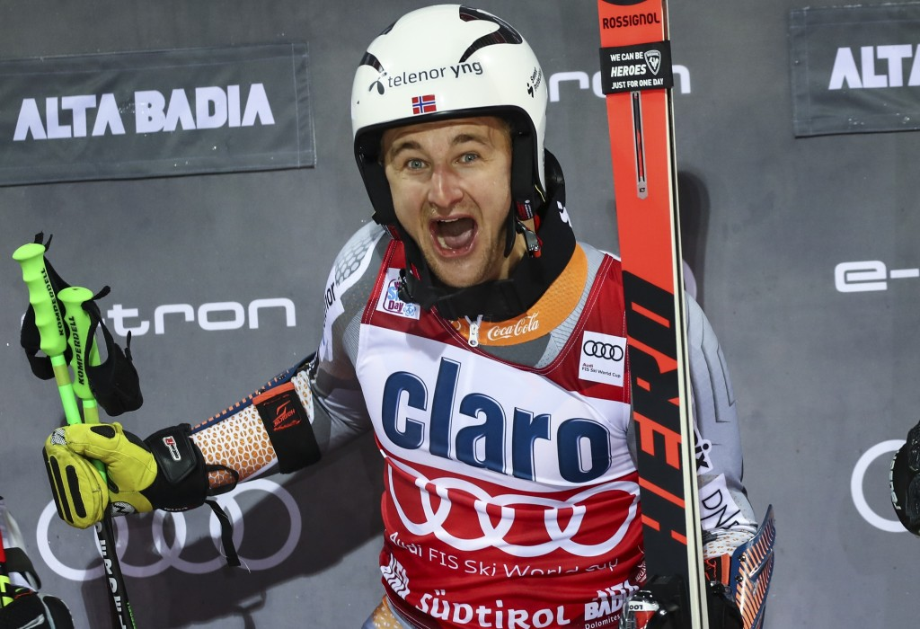 Norway's Rasmus Windingstad celebrates on the podium after winning an alpine ski, men's World Cup parallel giant slalom, in Alta Badia, Italy, Monday,...