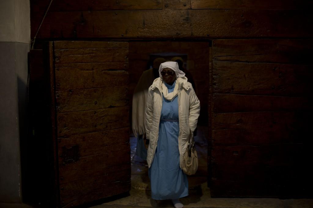 A Christian pilgrim from Nigeria enters the Church of the Nativity, built on top of the site where Christians believe Jesus Christ was born, on Christ...