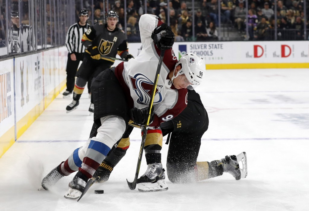 Colorado Avalanche right wing Mikko Rantanen (96) fights for the puck with Vegas Golden Knights defenseman Brayden McNabb (3) during the first period ...