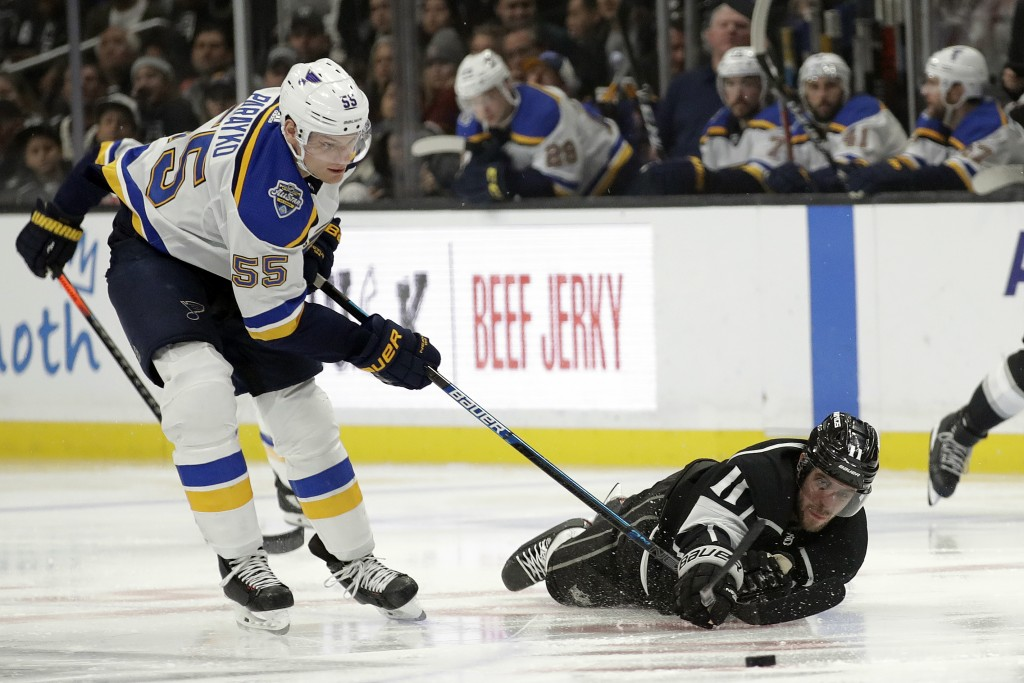 St. Louis Blues' Colton Parayko, left, and Los Angeles Kings' Anze Kopitar, vie for the puck during the third period of an NHL hockey game Monday, Dec...