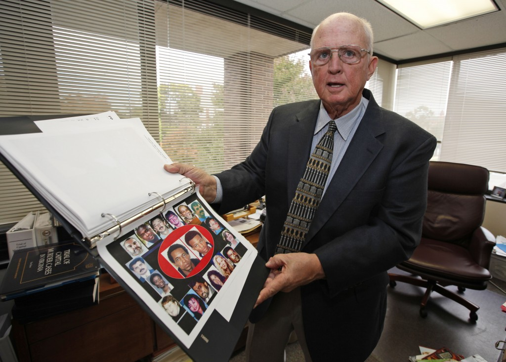 FILE - In this Oct. 22, 2009, file photo, Prince William County Commonwealth Attorney Paul Ebert displays a book of photos on the sniper trial during ...