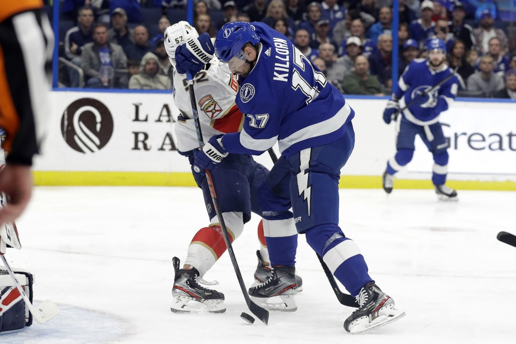 Tampa Bay Lightning left wing Alex Killorn (17) scores in front of Florida Panthers defenseman MacKenzie Weegar (52) during the second period of an NH...