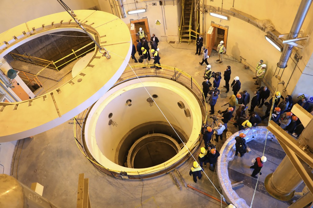 In this photo released by the Atomic Energy Organization of Iran, technicians work at the Arak heavy water reactor's secondary circuit, as officials a...