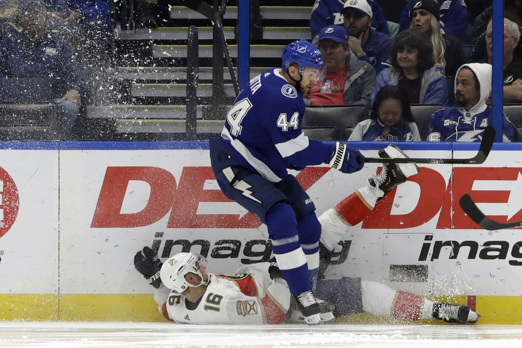 Tampa Bay Lightning defenseman Jan Rutta (44) sends Florida Panthers center Aleksander Barkov (16) to the ice during the second period of an NHL hocke...