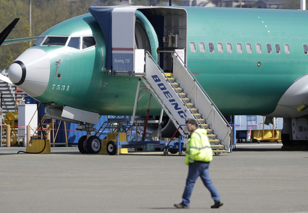 FILE - In this April 26, 2019, file photo a worker walks past a Boeing 737 Max 8 airplane being at Boeing's assembly facility in Renton, Wash. Boeing ...