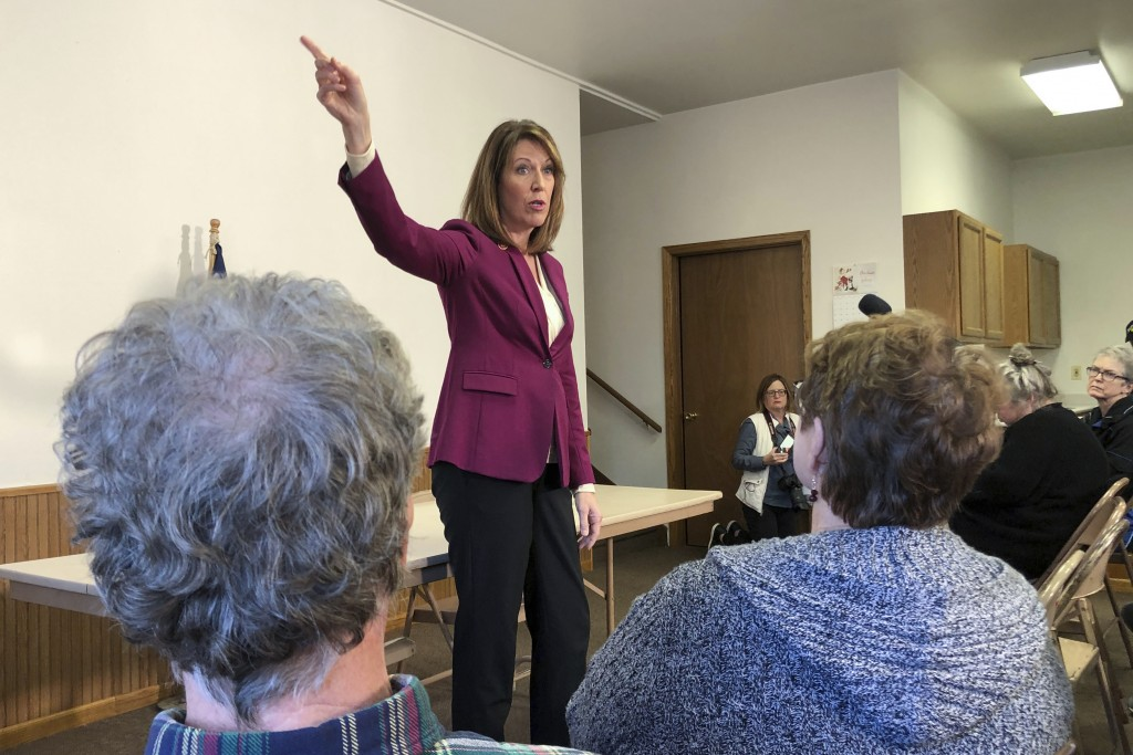 In this Saturday, Dec. 21, 2019, photo, Rep. Cindy Axne, D-Iowa., speaks to constituents about her vote on the USMCA trade deal in Guthrie Center, Iow...