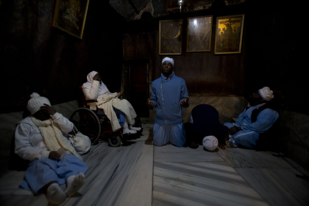 Christian pilgrims from Nigeria pray inside the Grotto of the Church of the Nativity, traditionally believed by Christians to be the birthplace of Jes...