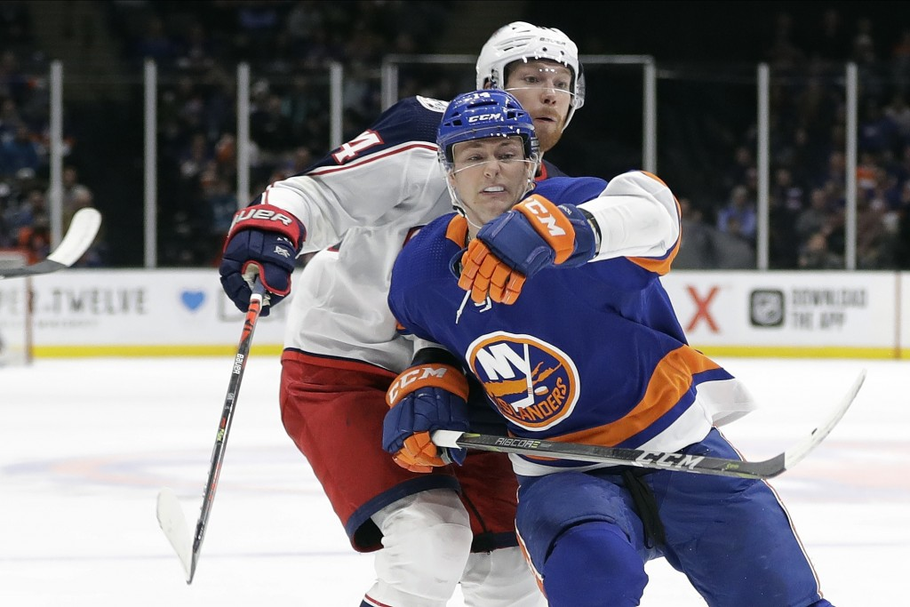 Columbus Blue Jackets' Vladislav Gavrikov, left, fights for position with New York Islanders' Tom Kuhnhackl during the second period of an NHL hockey ...