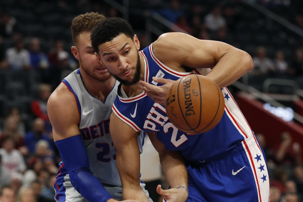 Detroit Pistons forward Blake Griffin (23) and Philadelphia 76ers guard Ben Simmons (25) chase the ball during the first half of an NBA basketball gam...