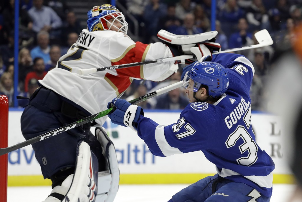 Tampa Bay Lightning center Yanni Gourde (37) crashes into Florida Panthers goaltender Sergei Bobrovsky (72) during the second period of an NHL hockey ...