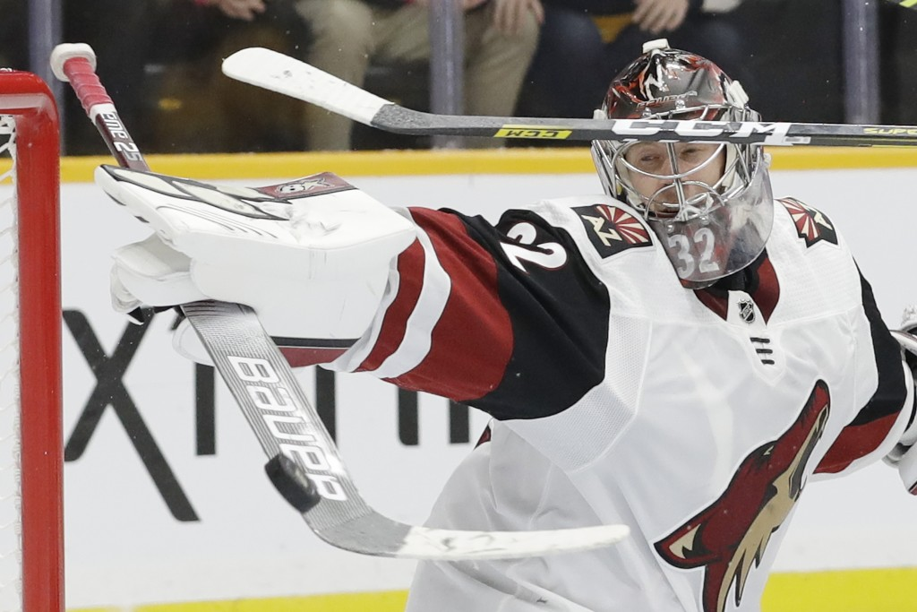 Arizona Coyotes goaltender Antti Raanta, of Finland, blocks a shot by the Nashville Predators during the second period of an NHL hockey game Monday, D...
