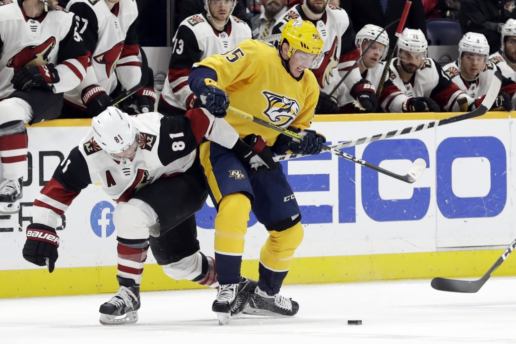 Nashville Predators center Matt Duchene (95) and Arizona Coyotes right wing Phil Kessel (81) compete for the puck in the second period of an NHL hocke...
