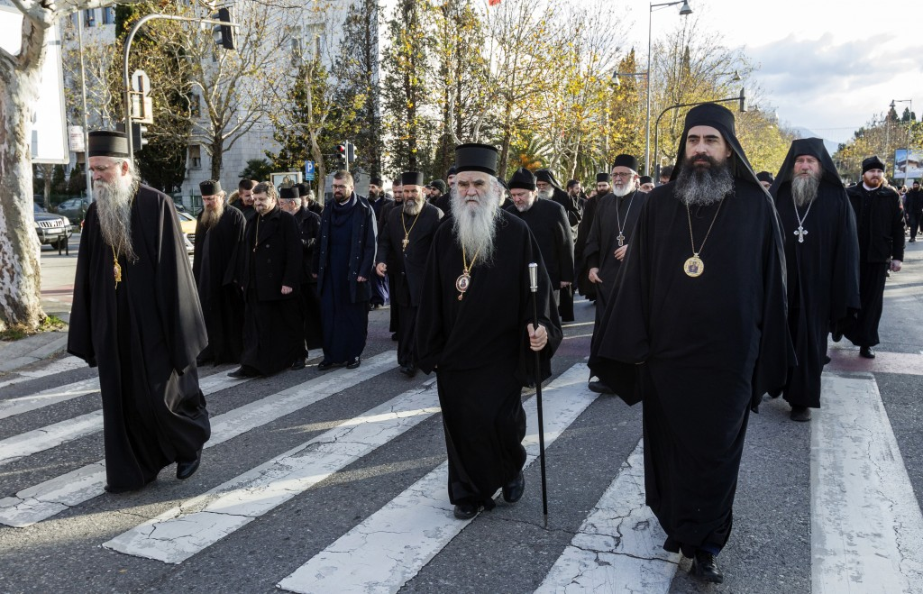 Serbian Orthodox Church clergy in Montenegro march as they protest the planned adoption of a religious law that they say will pave the way to strip th...