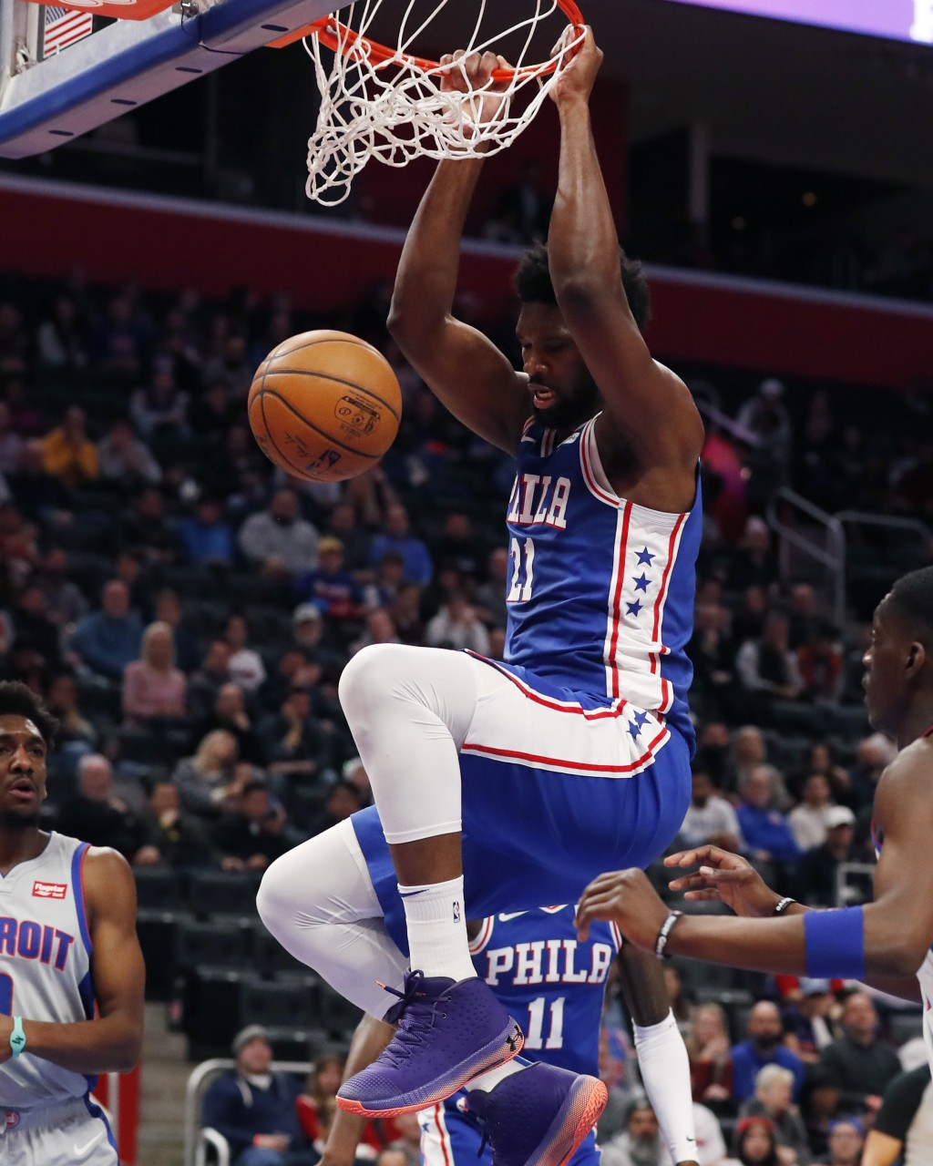 Philadelphia 76ers center Joel Embiid (21) dunks during the first half of the team's NBA basketball game against the Detroit Pistons, Monday, Dec. 23,...