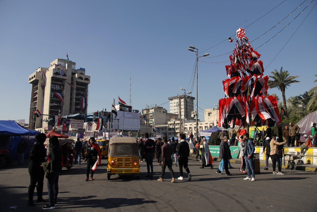 Anti-government protesters stage a sit-in at Tahrir Square during anti-government demonstrations in Baghdad, Iraq, Tuesday, Dec. 24, 2019. (AP Photo/K...
