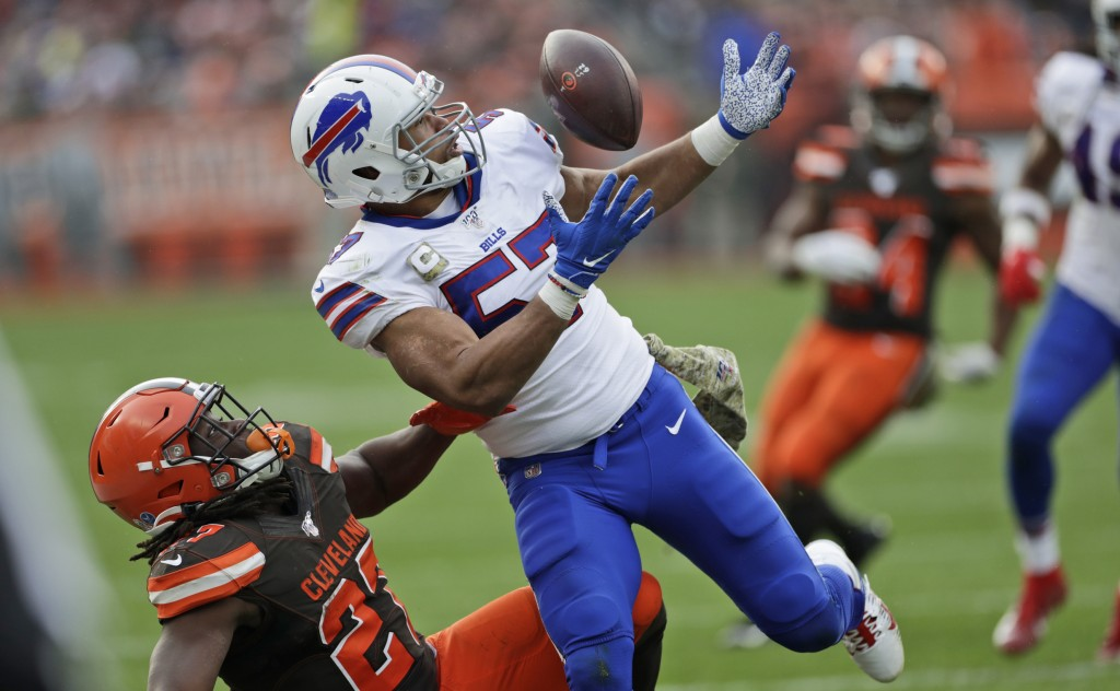 FILE - In this Nov. 10, 2019, file photo Buffalo Bills outside linebacker Lorenzo Alexander (57) breaks up a pass intended for Cleveland Browns runnin...