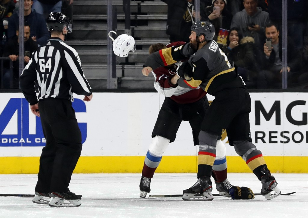 Vegas Golden Knights defenseman Deryk Engelland, right, fights with Colorado Avalanche right wing Valeri Nichushkin (13) during the second period of a...