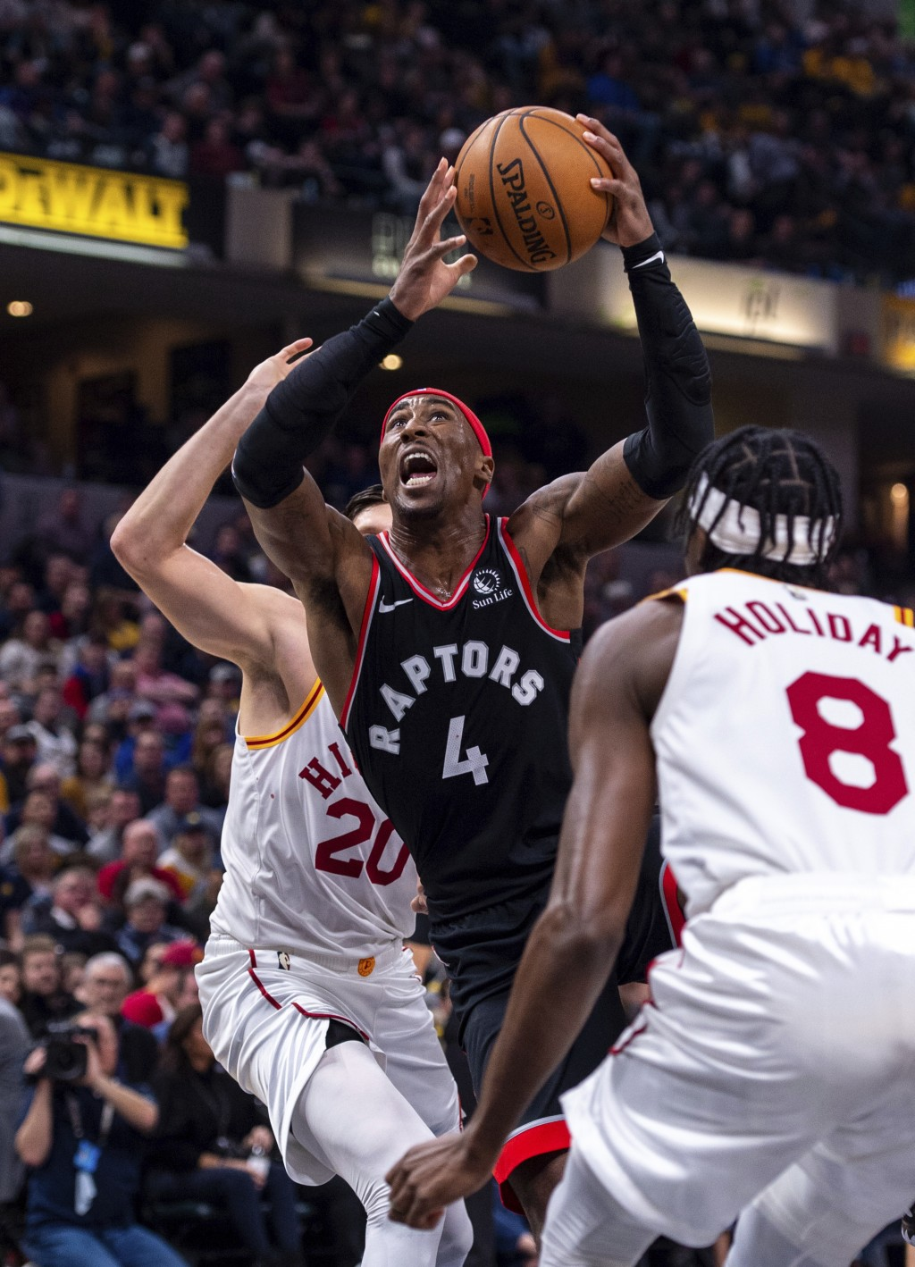 Toronto Raptors forward Rondae Hollis-Jefferson (4) shoots the ball during an NBA basketball game against the Indiana Pacers, Monday, Dec. 23, 2019, i...