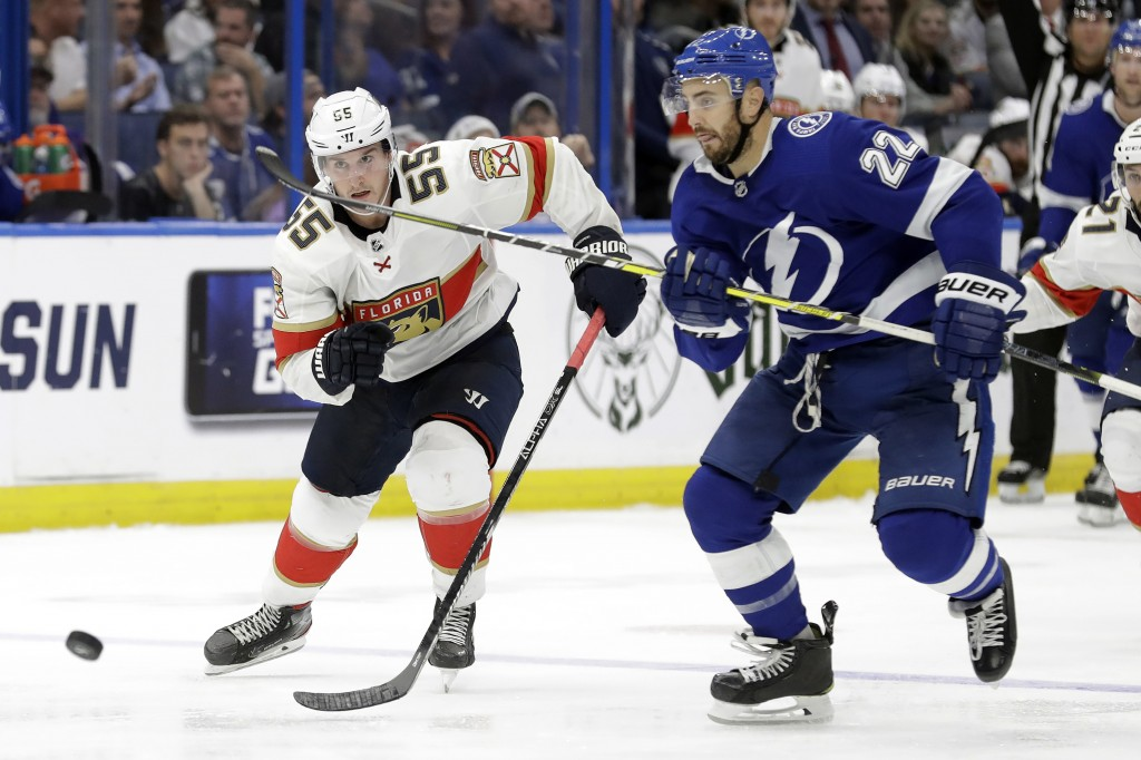 Florida Panthers center Noel Acciari (55) and Tampa Bay Lightning defenseman Kevin Shattenkirk (22) race for the puck during the third period of an NH...