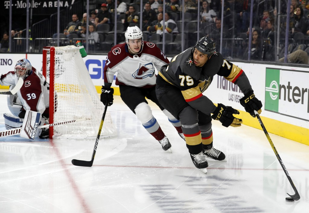 Vegas Golden Knights right wing Ryan Reaves (75) is pursued by Colorado Avalanche defenseman Ryan Graves (27) during the second period of an NHL hocke...