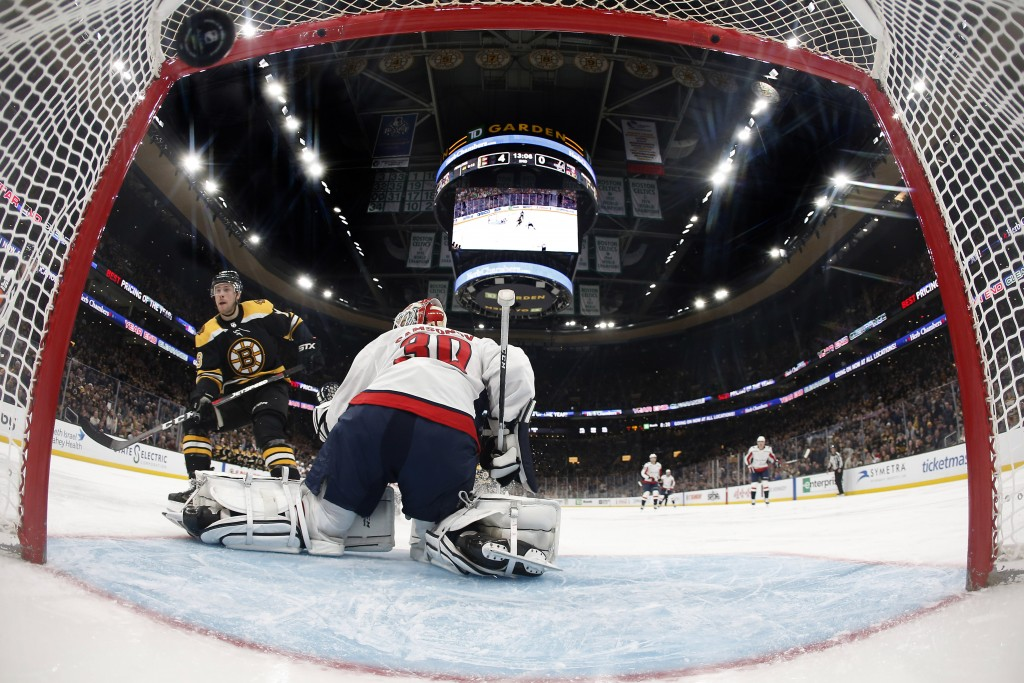 Boston Bruins' Charlie Coyle scores a shorthanded goal on Washington Capitals goaltender Ilya Samsonov during the second period of an NHL hockey game ...