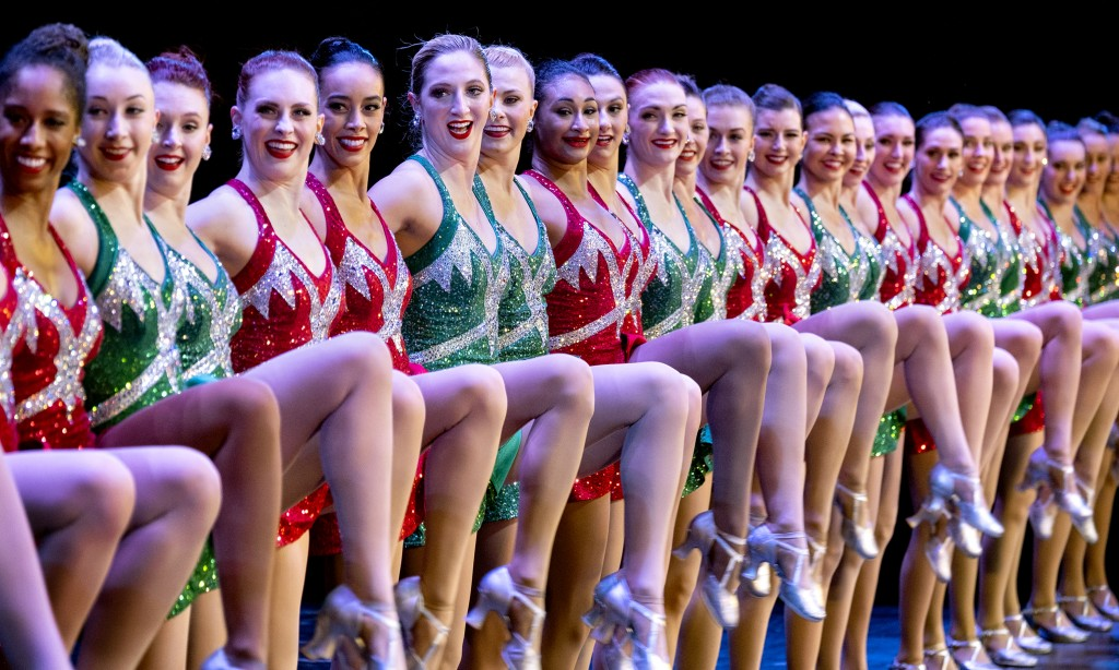 In this Monday, Nov. 25, 2019 photo, Rockette Sydney Mesher, sixth from left, dances during a performance of the Christmas Spectacular at Radio City M...