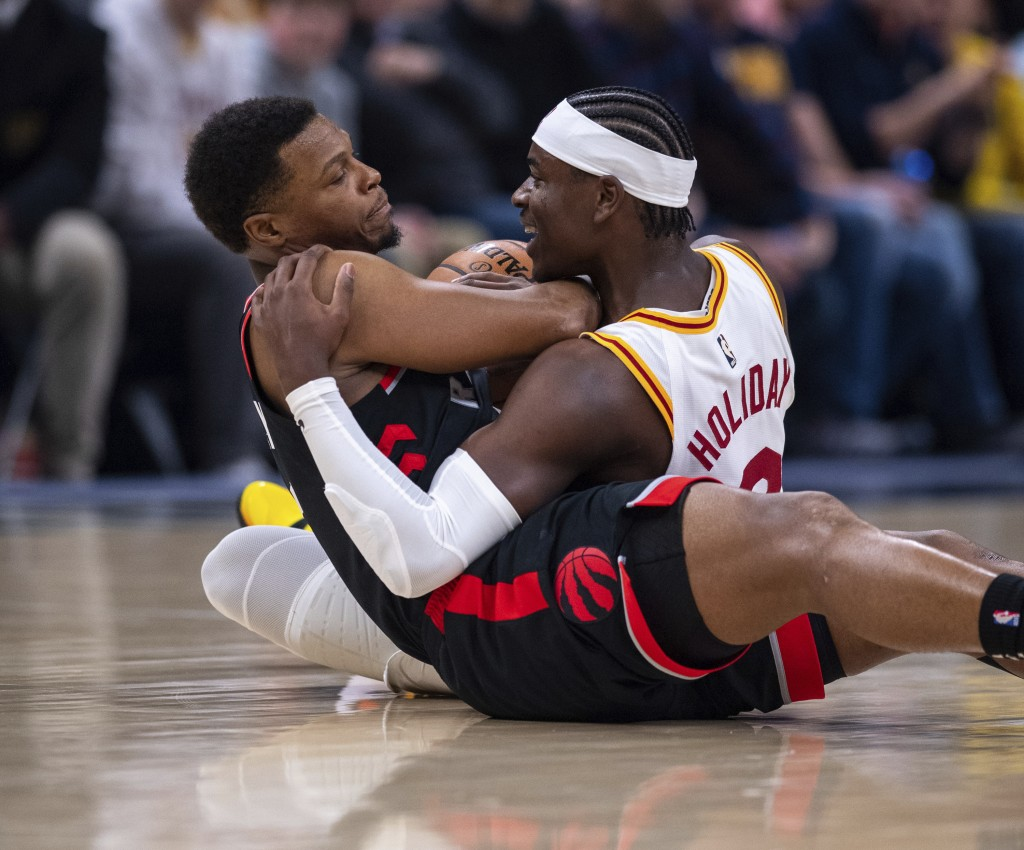 Indiana Pacers guard Aaron Holiday (3), right, and Toronto Raptors guard Kyle Lowry (7) battle for the ball during an NBA basketball game, Monday, Dec...