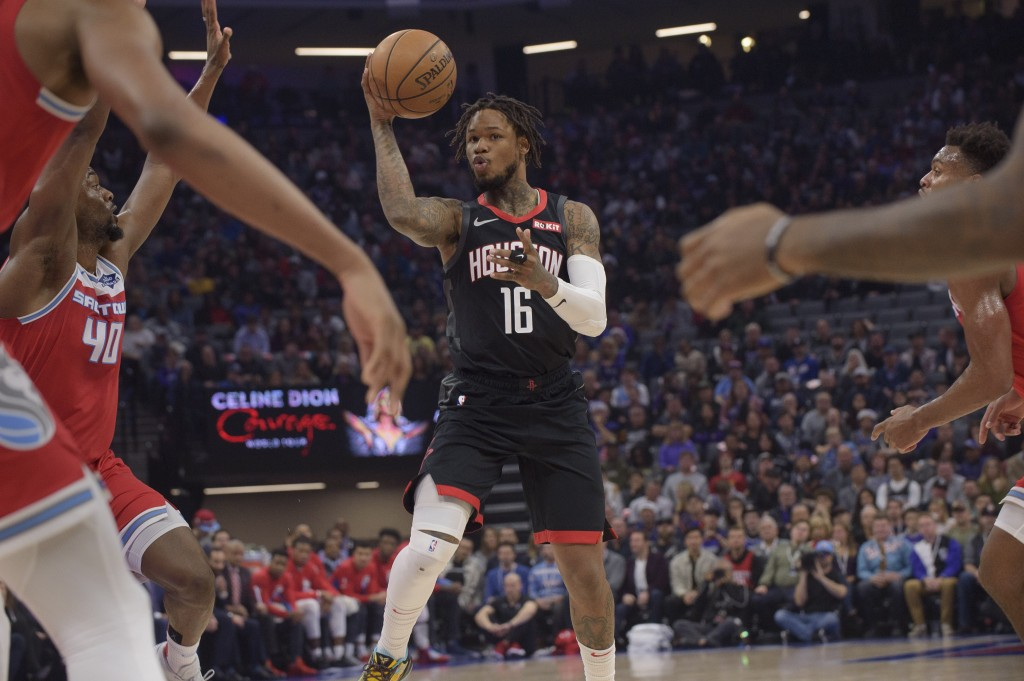Houston Rockets guard Ben McLemore (16) passes the ball during the first quarter of the team's NBA basketball game against the Sacramento Kings in Sac...
