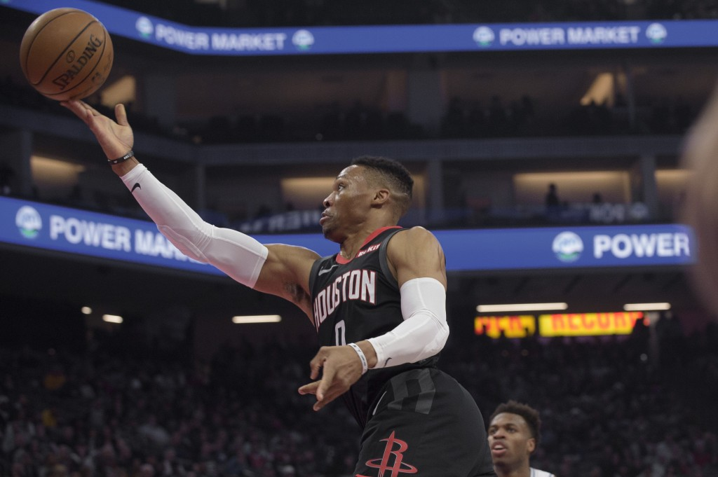 Houston Rockets guard Russell Westbrook (0) lays the ball up during the first quarter of the team's NBA basketball game against the Sacramento Kings i...