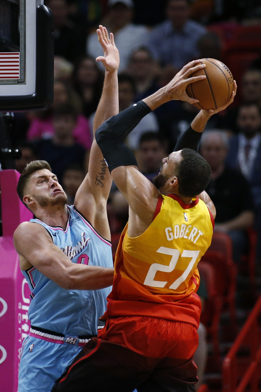 Miami Heat forward Meyers Leonard (0) attempts to block a shot by Utah Jazz center Rudy Gobert (27) during the first half of an NBA basketball game, M...