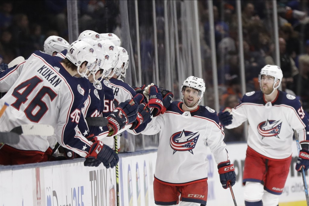 Columbus Blue Jackets' Nathan Gerbe celebrates with teammates after scoring a goal during the second period of an NHL hockey game against the New York...