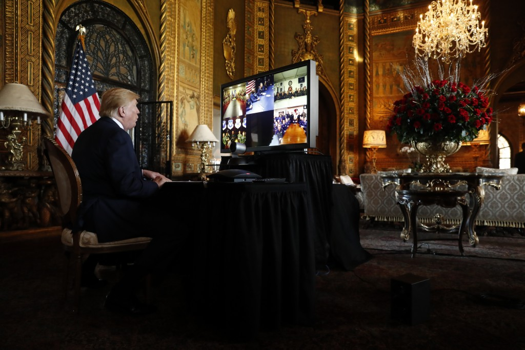 President Donald Trump speaks during a Christmas Eve video teleconference with members of the military at his Mar-a-Lago estate in Palm Beach, Fla., T...