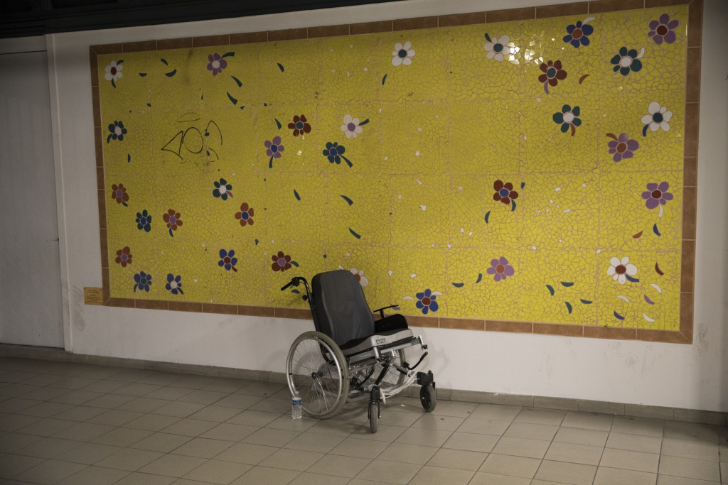 This photo taken on Dec.9, 2019 shows an empty wheelchair at the entrance to La Timone hospital in Marseille, southern France. In a hospital in Marsei...