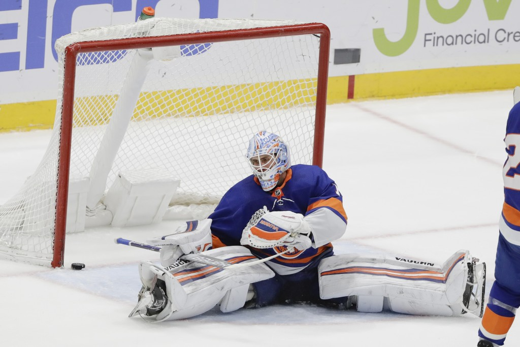 New York Islanders goaltender Thomas Greiss reacts after Columbus Blue Jackets' Vladislav Gavrikov scored a goal during the third period of an NHL hoc...